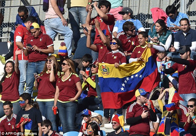 Venezuela fans with their flag in copa america